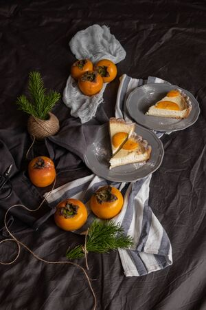 curd dessert with persimmon on a dark background. Vintage. Beautiful table setting. Stock fotó
