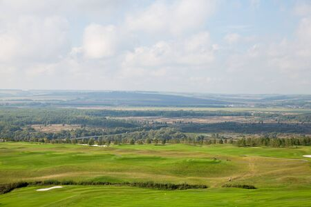 Aerial view of a green golf course, golf course on a sunny day. nature