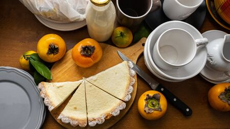pie with cottage cheese and persimmon top view. Cheesecake. Beautiful serving Stock fotó