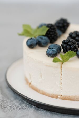 fragments of classic cheesecake with fresh berries on a gray background. close-up. Minimalism