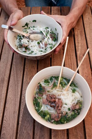 two plates of pho bo. Vietnamese soup pho bo. Panasian cuisine. Veal and Noodle Soup