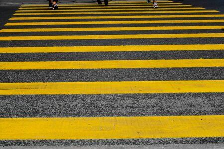 Crosswalk yellow lines on the road. zebra yellow pedestrian crossing
