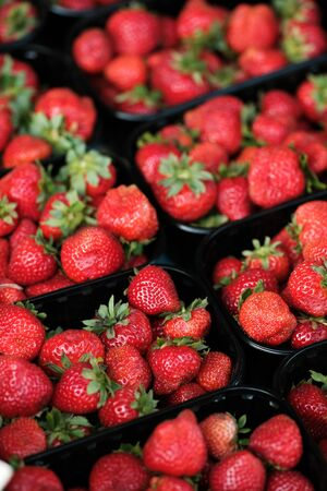Baskets with fresh delicious strawberry. Tasty summer berries - a source of vitamins. Selective focus