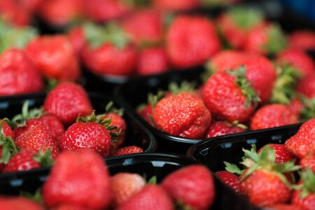 Natural organic strawberry in boxes at a farmers market. strawberry background Stock Photo