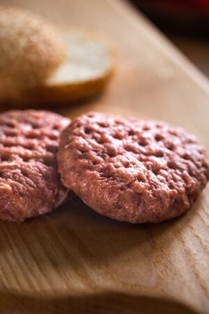 Raw beef cutlets for burgers cooking. Concept of american fast food. Juicy american burger with beef cutlet. Tasty grilled home made burgers cooking