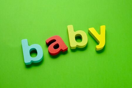 Word BABY HOPE made of color wooden letter on green background. Learning the English alphabet and the English language. The concept of child education, school, kindergarten,preschool education