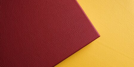 Yellow and red genuine leather. The texture of genuine leather. Cover for photo album or photo book. Texture of genuine leather yellow and red colors Фото со стока - 140949158