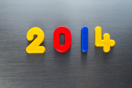 brushed aluminum: the year 2014 writen with plastic numbers on a brushed aluminum surface Stock Photo
