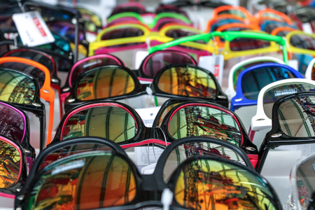 many colorful sunglasses in a flee market photo