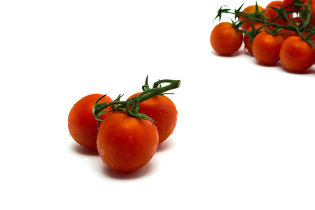 three cherry tomatoes in-front Stock Photo