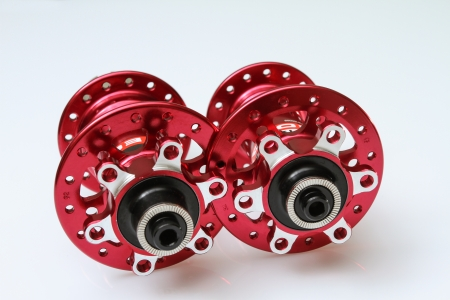 a brand new pair of red hubs for mountain bikes.
