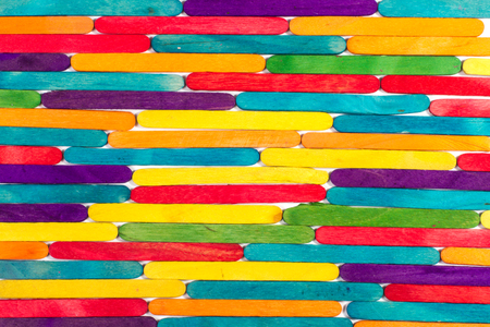 group of colored ice pop wood sticks set to create background