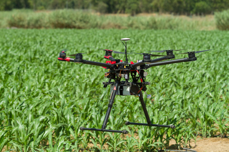 drones: Hexacopter UAV drone in support of agriculture Stock Photo