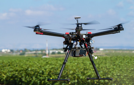 drone: Hexacopter UAV drone in support of agriculture Stock Photo