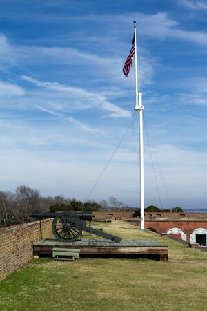 tybee island: Cannon and Flag at Fort Pulaski next to Tybee island