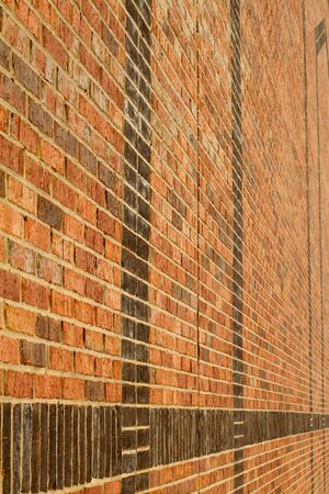 vertical image of endless bricks wall. Shallow DOF