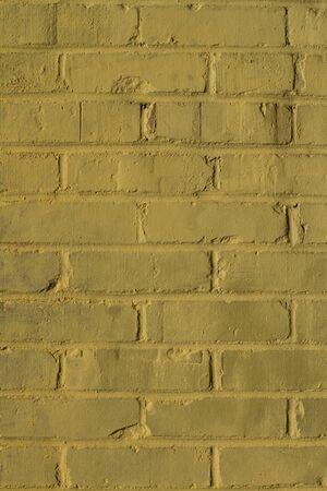 yellow grunge bricks wall close-up