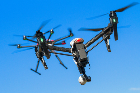 two drones flying one after the other during a chase