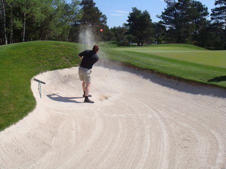 golf swing in sand trap