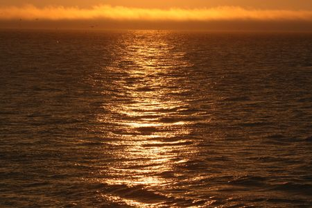 sunrise on the water of the atlantic ocean Stock Photo