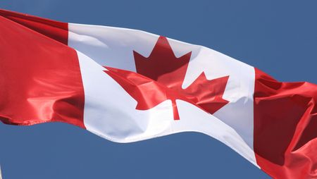 a canadian flag flaps in the wind photo