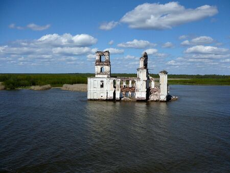 An abandon fortress sits in the middle of Volga river photo