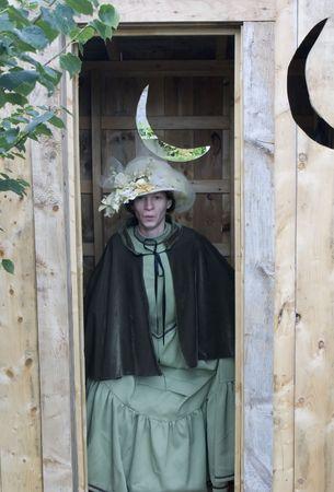 latrine: Woman using outhouse Stock Photo