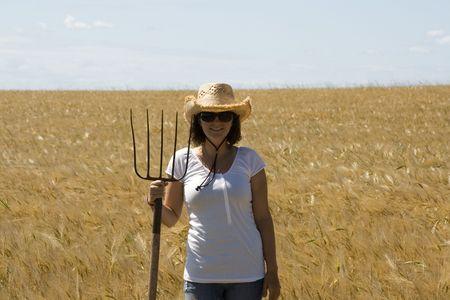 Smiling farm girl photo