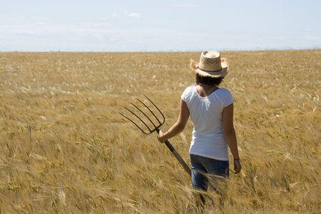 Woman overlooking a farm field photo