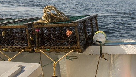 lobster boat: Lobster trap on a boat Stock Photo
