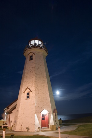 Lighthouse and Moon photo