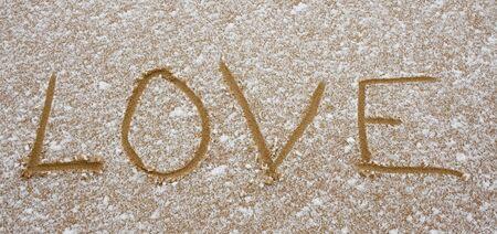 Love printed on sand
