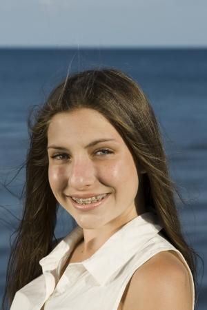 Teen with braces photo