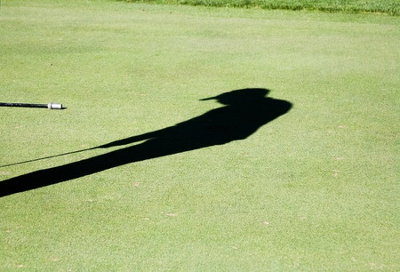 shadow: Shadow of a golfer