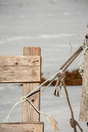 post: fence post and rope Stock Photo