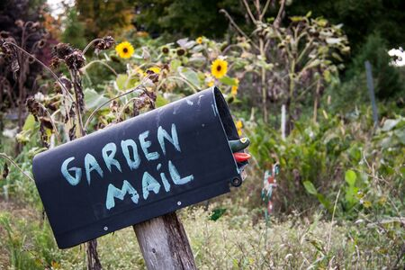 mailbox with garden mail Stock Photo