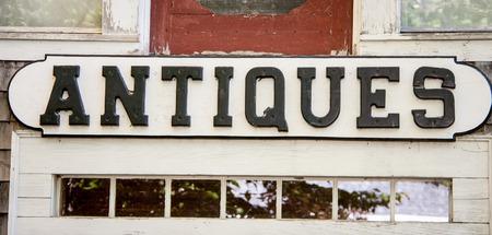 antiques: wooden antiques sign
