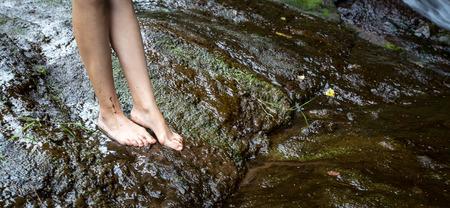 muddy: feet on a muddy bank Stock Photo