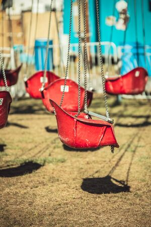 chain swing ride: red swing seat