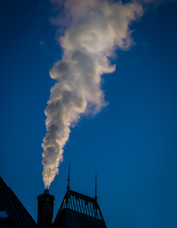 white exhaust from a building