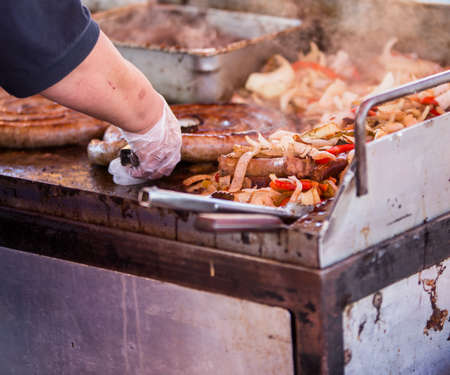 food state: cooking sausages and onions