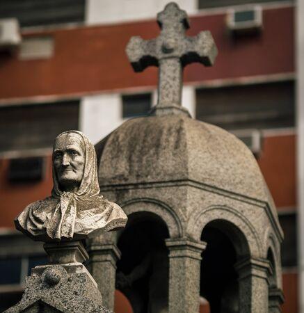statue and cross Recoleta Stock Photo