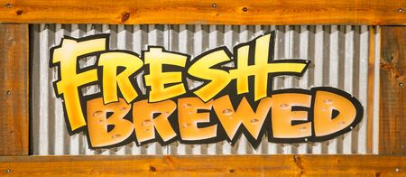 advertise with us: fresh brewed sign Stock Photo