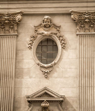 cherub: cherub face above a window Stock Photo