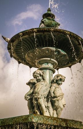 cherubs: cherubs on a fountain
