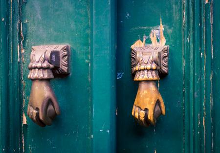 doorknocker: hand doorknocker Stock Photo