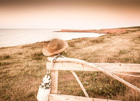 straw hat on a post
