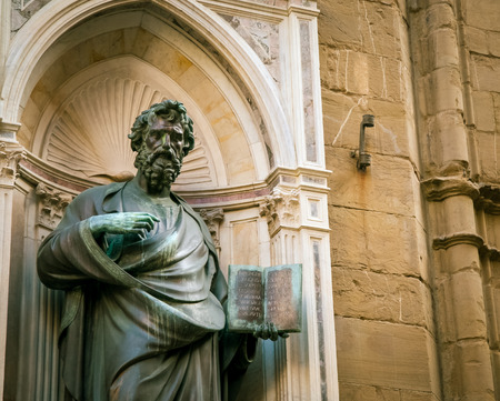statue holding a bible