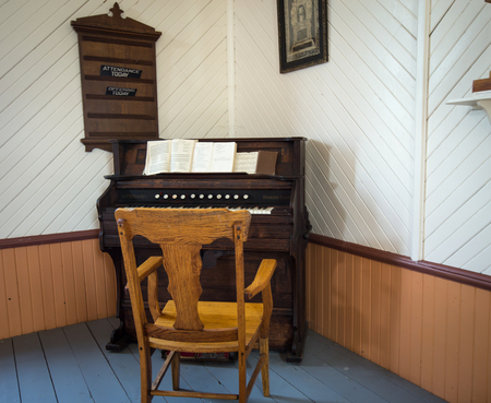 hymn: old organ and chair