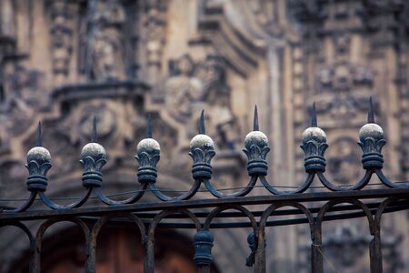 spiked fence in front of the cathedral Banco de Imagens